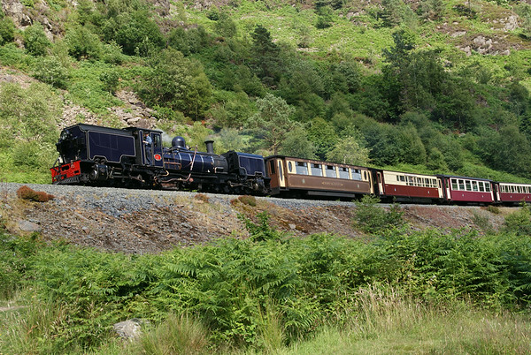 Welsh Highland Railway Garrett No 87  heading north through the Aberglaslyn pass with the afternoon service.