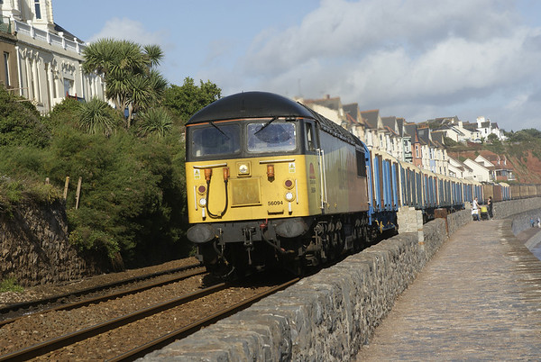 Colas Rail's 56094 heads a rake of timber empties bound for Heathfield through Dawlish