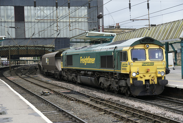 Freightliner Heavy Haul's 66553 pauses at Carlisle on a northbound train of coal empties returning to Scotland.