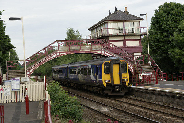 Northern Rail's 156448 enters Haltwhistle with a Newcastle to Carlisle train, on the northermost of the trans-Pennine lines.