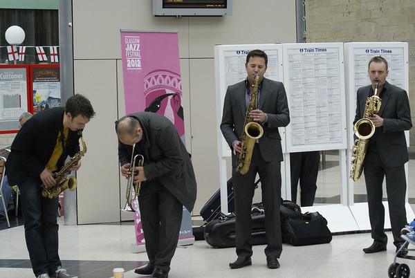 Jazz four-piece Brass Jaw play an impromptu set on the concourse of Carlisle station to promote the Glasgow Jazz festival.