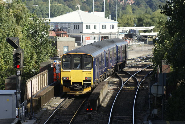 One of the two three-car pre-production prototype class 150s leaves Reading West on a Basingstoke-Reading service.
