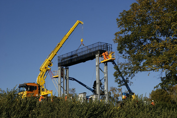 A new signal gantry being erected on the curve between Reading West and Reading